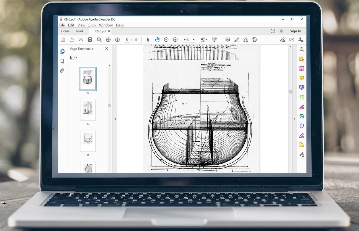 adob acrobat showing pdf on a laptop